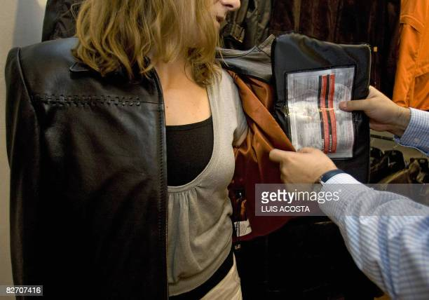 A model displays a bulletproof jacket disigned by Colombian Miguel Caballero in Mexico City on September 3 2008 The demand for vigilance armored cars...