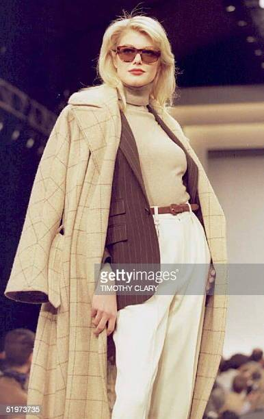 A model displays a cream colored shirt with white pants and grey wool jacket during the Ralph Lauren Fall 1995 fashion show in New York 05 April 1995...