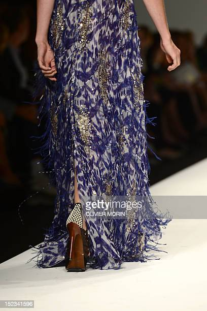 A model displays a creation as part of Elena Miro SpringSummer 2013 fashion show on September 19 2012 during the Women's fashion week in Milan AFP...