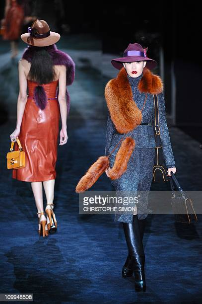 A model displays a creation as part of Gucci FallWinter 20112012 readytowear collection on February 23 2011 during the Women's fashion week in Milan...