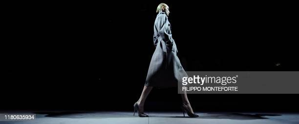A model displays a creation as part of Salvatore Ferragamo FallWinter 20112012 readytowear collection on February 27 2011 during the Women's fashion...