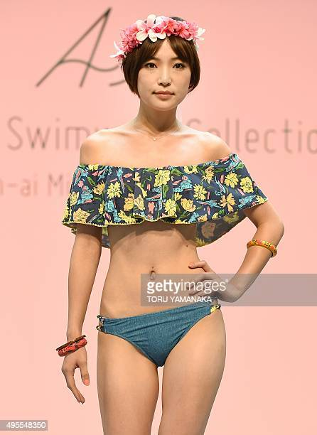 A model displays a creation at the 2016 swimwear collection show by Japanese apparel maker Ai in Tokyo on November 4 2015 AFP PHOTO/Toru YAMANAKA