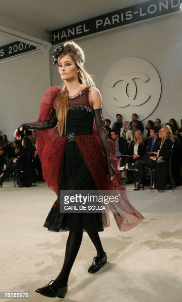 Model displays a creation at the Chanel 2007/2008 collection show, London 06 December 2007. AFP PHOTO/CARL DE SOUZA