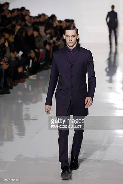 Model displays a creation by Belgian designer Kris Van Assche for the label Dior during the men's Fall-Winter 2013-2014 collection show on January...
