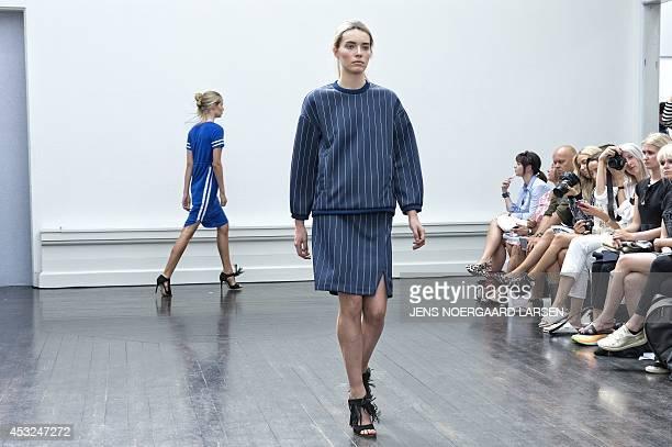Model displays a creation by Danish fashion house Baum und Pferdgarten during the Copenhagen Fashion Week 2014 on August 6, 2014. AFP PHOTO / SCANPIX...