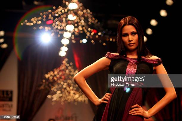 A model displays a creation by designer Rohit Bal at Wills India Fashion Week in New Delhi