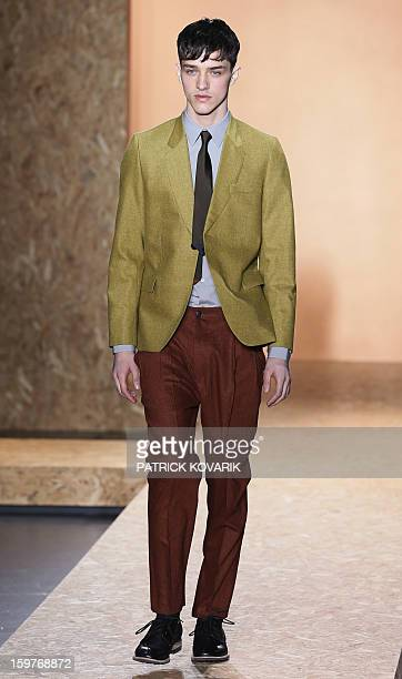 A model displays a creation by English designer Paul Smith on January 20 2013 during the men's fallwinter 20132014 fashion week in Paris AFP PHOTO /...