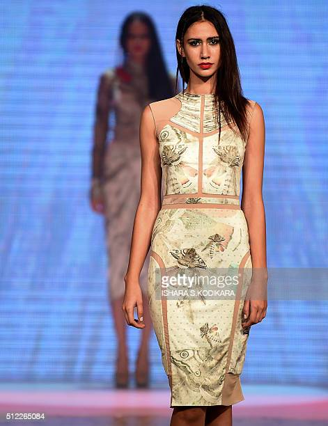 A model displays a creation by fashion designer Agent at Colombo fashion week on February 25 2016 Colombo fashion week started on February 23 with...
