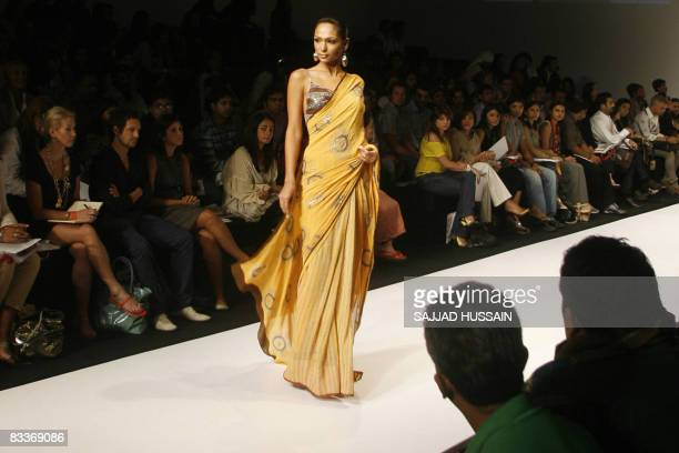 A model displays a creation by Indian designer Anupama during the second day of the Lakme India Fashion Week in Mumbai on October 21 2008 Some 75...