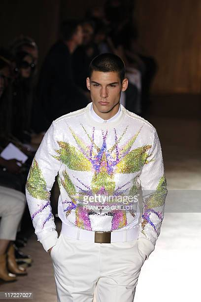 Model displays a creation by Italian fashion designer Ricardo Tisci for Givenchy during his men's spring-summer 2012 fashion collection show on June...