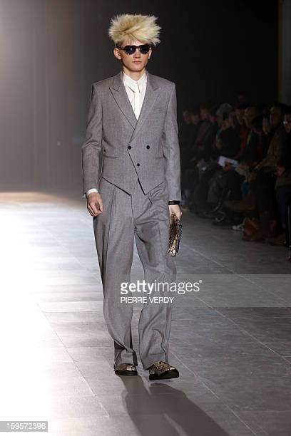 Model displays a creation by Japanese designer Arashi Yanagawa for the label John Lawrence Sullivan during the men's Fall-Winter 2013-2014 collection...