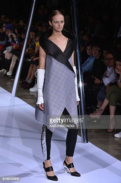 A model displays a creation by Japanese designer Keiichiro Yuri during the 'Keiichirosense' collection show at Amazon Fashion Week in Tokyo on...