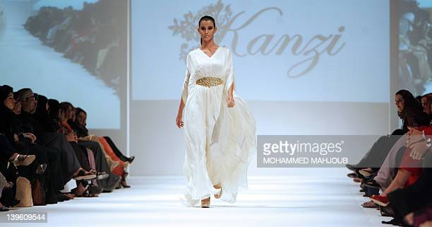 A model displays a creation by Kanzi designers Sheikha Amal alMaktoum and Raghda Taryam during the Muscat Fashion Week in the Omani capital late on...