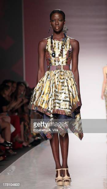 Model displays a creation by Kiki Clothing during It's Ethical Fashion 'Bring Africa to Rome' catwalk collection S/S 2014 fashion show as part of...