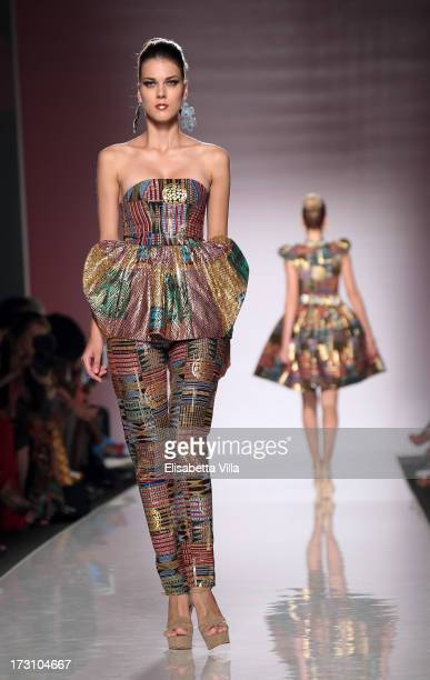 A model displays a creation by Kiki Clothing during It's Ethical Fashion 'Bring Africa to Rome' catwalk collection S/S 2014 fashion show as part of...