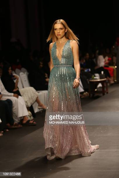 A model displays a creation by Lebanese designer Antoine Salameh during the launch of the 6th edition of the Ladies A La Mode fashion show on January...