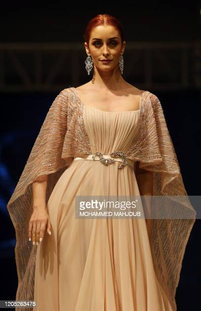 A model displays a creation by Lebanese designer Antoine Salameh during the launch of the 7th edition of the Ladies a La Mode fashion show on March 4...
