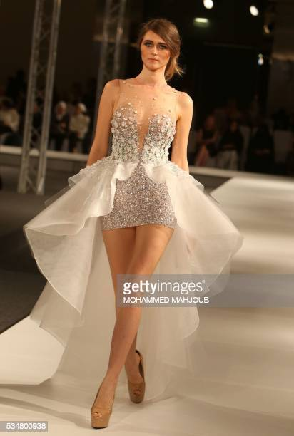 A model displays a creation by Lebanese designer Antoine Salameh during the launch of the 4th edition of the Ladies a La Mode fashion show on May 27...
