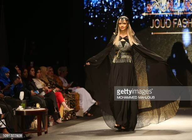 A model displays a creation by Omani designer Aishsh Abedelaziz during the launch of the 6th edition of the Ladies A La Mode fashion show on January...