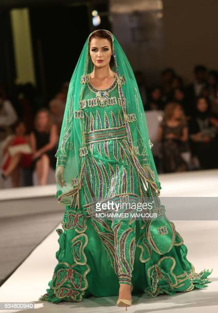 A model displays a creation by Omani designer Anisa alZadjali during the launch of the 4th edition of the Ladies a La Mode fashion show on May 27 in...