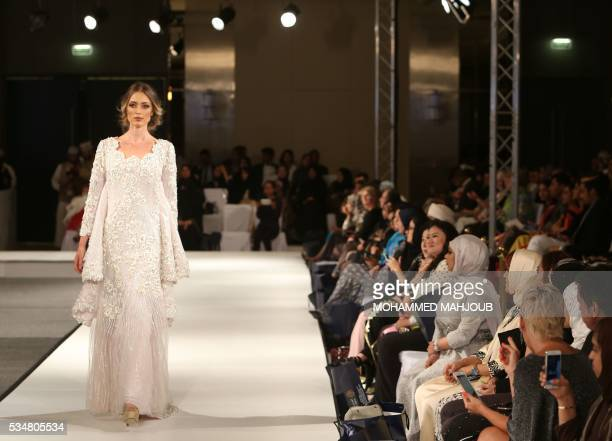 A model displays a creation by Omani designer Buthaina alZadjali during the launch of the 4th edition of the Ladies a La Mode fashion show on May 27...