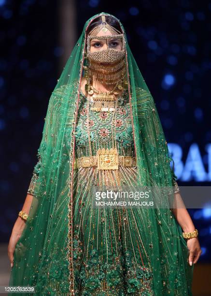 A model displays a creation by Omani designer Faiza alBalushi during the launch of the 7th edition of the Ladies a La Mode fashion show on March 4...