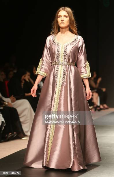 A model displays a creation by Omani designer Nourah Karim during the launch of the 6th edition of the Ladies A La Mode fashion show in the Omani...