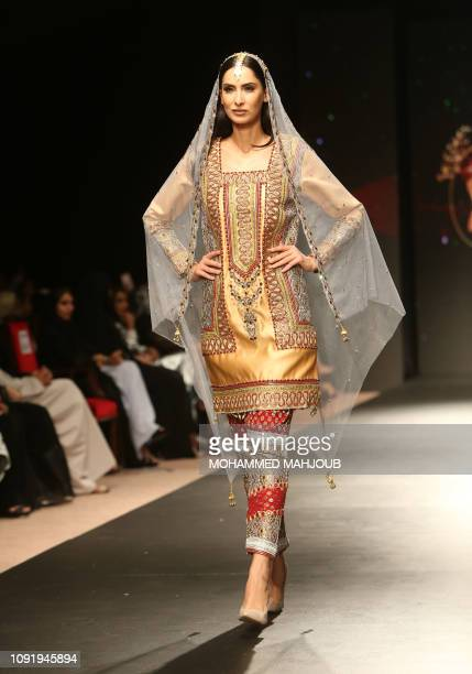 A model displays a creation by Omani designer Shaimaa alWahibi during the launch of the 6th edition of the Ladies A La Mode fashion show in the Omani...