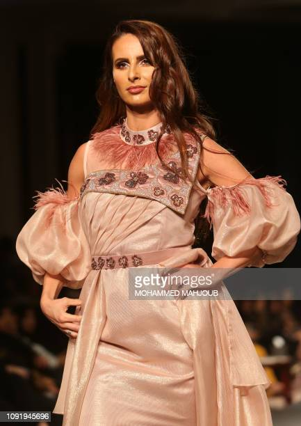 A model displays a creation by Omani designer Soumia alShairje during the launch of the 6th edition of the Ladies A La Mode fashion show in the Omani...
