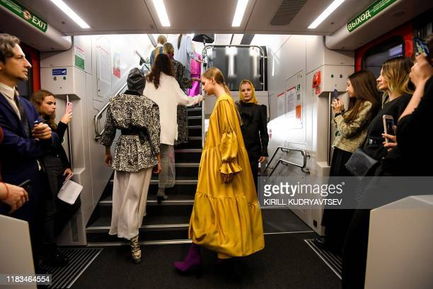 Model displays a creation by Russian fashion designers Arshaevy as part of Modest Fashion Week in Moscow on November 19, 2019. - There is the first...