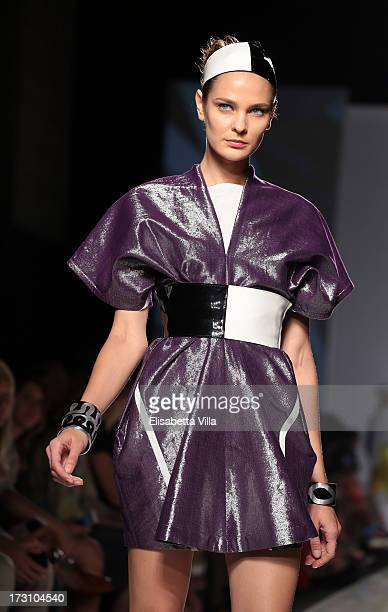 A model displays a creation by Sabine Portenier and Evelyne Roth during It's Ethical Fashion 'Bring Africa to Rome' catwalk collection S/S 2014...