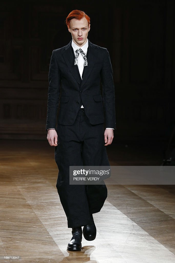 A model displays a creation by South Korea designer Songzio on January 19, 2013 during the men's fall-winter 2013-2014 fashion week in Paris.