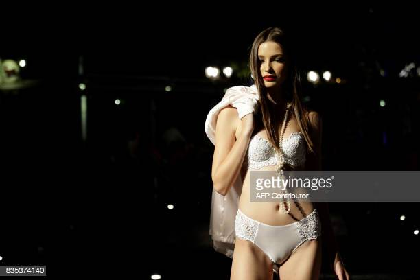 A model displays a creation during a lingerie fashion shows the in town of Dbayeh north of the Lebanese capital Beirut on August 18 2017 / AFP PHOTO...