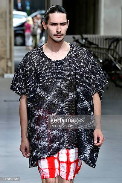 Model displays a creation for the Japanese label Issey Miyake during the men's spring-summer 2013 fashion collection show on June 28, 2012 in Paris....
