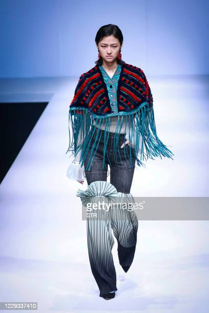 A model displays a creation from Different Dress up collection designed by Yao Lily during the China Fashion Week in Beijing on October 29 2020 /...
