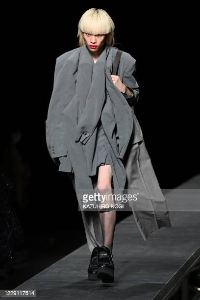 A model displays a creation from fashion brand RequaL by Japanese designer Tetsuya Doi for the 2021 spring/summer collection at Tokyo Fashion Week on...
