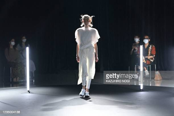 Model displays a creation from fashion brand UCF by UCF design team for the 2022 Spring/Summer collection at Tokyo Fashion Week on September 2, 2021.