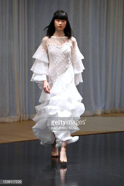 Model displays a creation from fashion brand Zin Kato by Japanese designers Zin Kato for the 2021 spring/summer collection at Tokyo Fashion Week on...