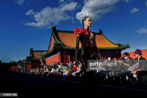"""Model displays a creation from the """"Chantel Gong"""" by Gong Hangyu during Beijing Fashion Week in Beijing on September 17, 2020."""