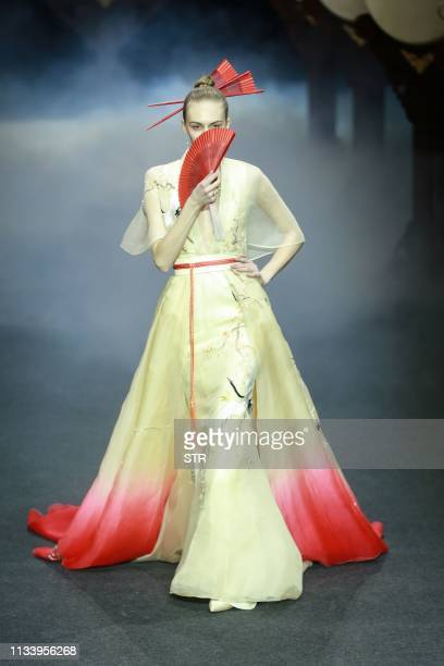 A model displays a creation from the Heaven Gaia collection by Xiong Ying during the China Fashion Week in Beijing on March 31 2019 / China OUT