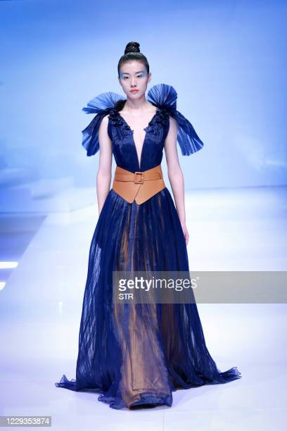 Model displays a creation from the SF Dress collection designed by Zhang Quan during the China Fashion Week in Beijing on October 30, 2020. / China...