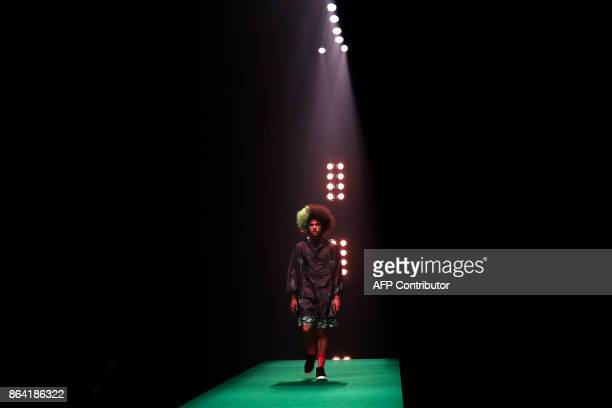 A model displays a creation from Yukihero ProWrestling designed by Yukihiro Teshima during the Amazon Fashion Week Tokyo 2018 spring/summer...