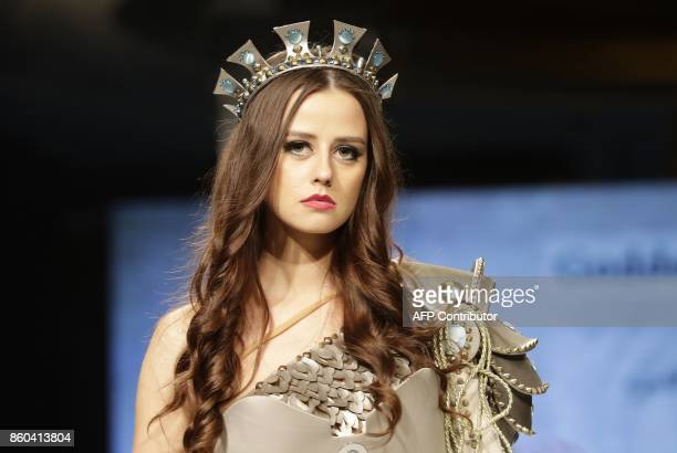 A model displays a creation inspired by Godess Atarghatis the chief goddess of northern Syria in Classical Antiquity by Syrian fashion designer Manal...