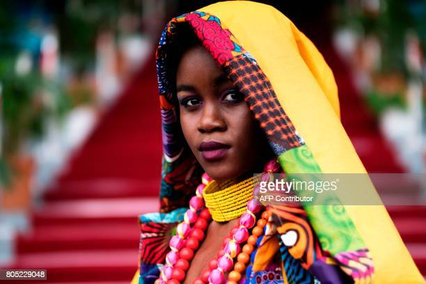 A model displays a creation of a local designer during the fashion show at the 2017 edition of the Durban July horse race in Durban on July 01 2017 /...