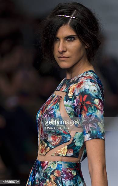 A model displays a creation of Colombian designer Jorge Duque Velez during the presentation of the SpringSummer collection in the framework of the...