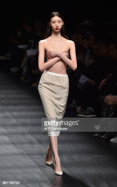 A Model Displays A Creation Of Dressedundressed Designed By Takeshi Kitazawa And Emiko Sato During The