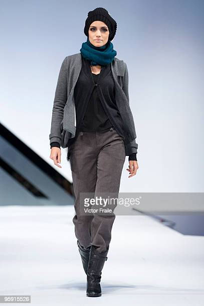 A model displays a creation of JM Group's The Layering Seminar collection on the catwalk during the Brand Collection Show II show as part of the Hong...