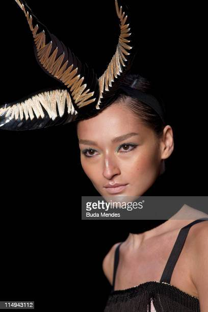 A model displays a design by Acquastudio during the Fashion Rio Summer 2012 at Pier Maua on May 30 2011 in Rio de Janeiro Brazil