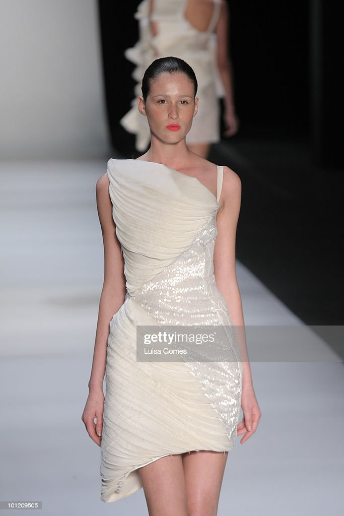 A model displays a design by Acquastudio during the first day of Fashion Rio Summer 2011 at Pier Maua on May 27, 2010 in Rio de Janeiro, Brazil.