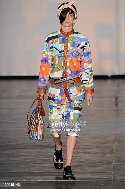 A model displays a design by Amapo during the fifth day of the Sao Paulo Fashion Week Summer 2011 at the Ibirapuera's Bienal Pavilion on June 13 2010...